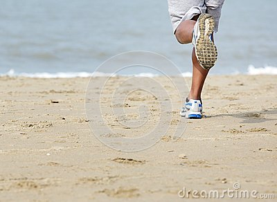 Rear view of man jogging at the beach