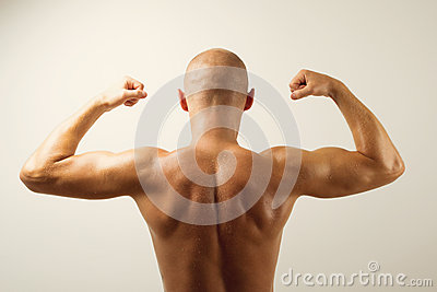 Rear view of muscular man showing his back muscles