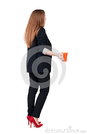 Free Rear View Of A Young Business Woman Drinking Coffee Or Tea While Royalty Free Stock Photos - 44418858