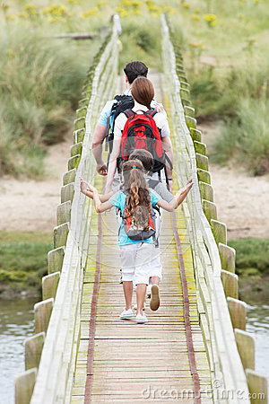 Free Rear View Of Family Walking Along Wooden Bridge Royalty Free Stock Photography - 33088557