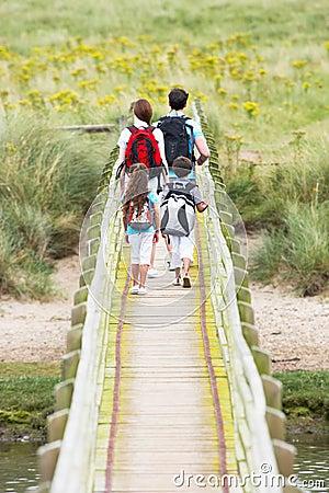 Free Rear View Of Family Walking Along Wooden Bridge Royalty Free Stock Photo - 33088585
