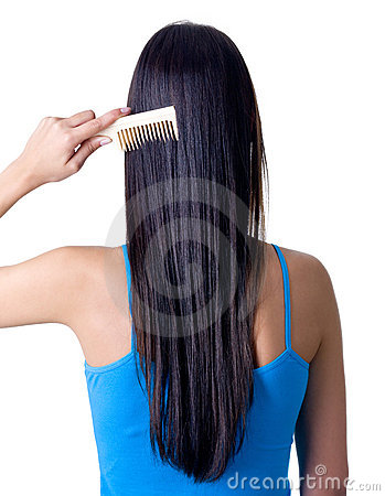 Free Rear View Of Girl Combing Hair Royalty Free Stock Photography - 16759237