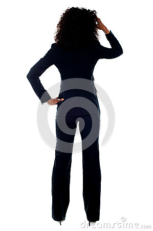 Rear view portrait of confused businesswoman