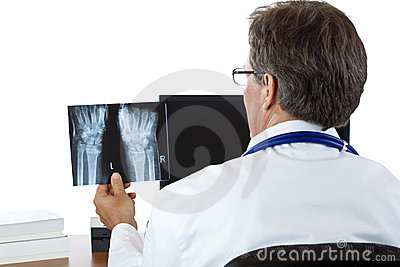 Rear view of radiologist examining radiography