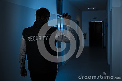 Security Guard Standing In Corridor Of The Building Stock Photo