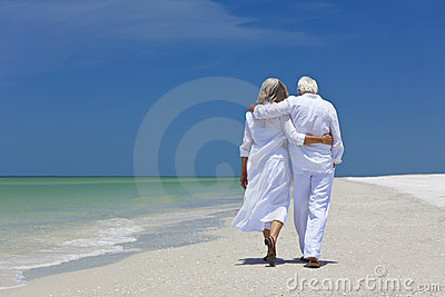 Rear View Senior Couple Walking on Tropical Beach