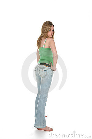 Rear view of sexy woman in faded blue jeans