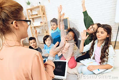 Rear view of teacher who teaches lesson in elementary school. Children`s primary education concept. Stock Photo