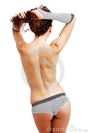 Rear view of topless girl in shorts and gloves.