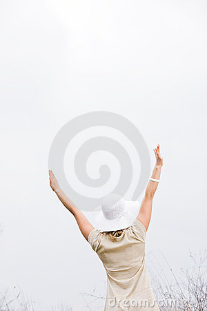 Rear View of Woman With Arms Raised
