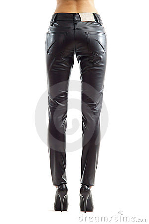 Rear view of woman legs in black leather trousers