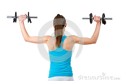 Rear view of woman lifting weights.
