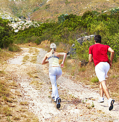 Rear view of a young couple jogging