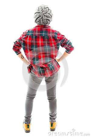 Rear view of a young woman standing with her arms akimbo