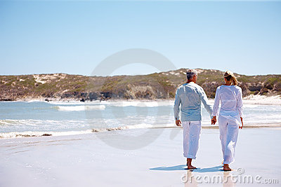 Rear viewof a couple holding hands and walking