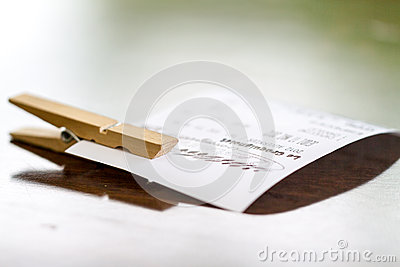 Receipt and clothespin