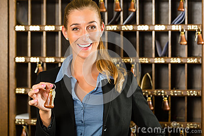 Reception of hotel - woman holding key in hand