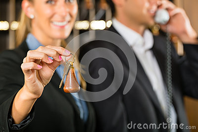 Reception in Hotel - woman with key