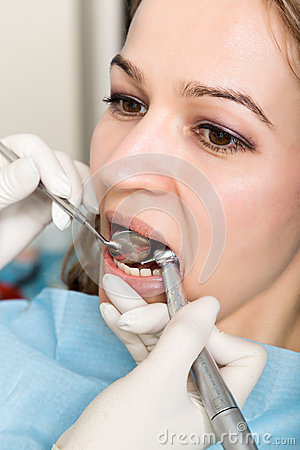 The reception was at the female dentist. Doctor examines the oral cavity on tooth decay. Caries protection. Tooth decay Stock Photo