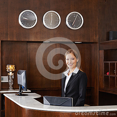 Receptionist behind counter at hotel