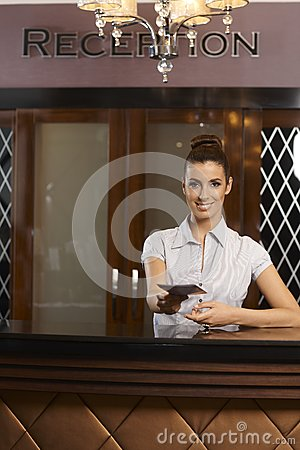 Receptionist handing information brochure