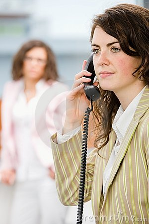 Receptionist receiving phone calls