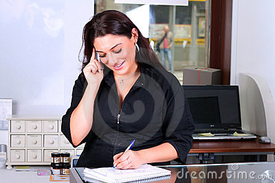 Receptionist taking note