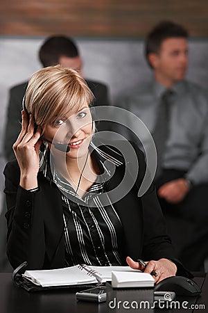 Receptionist talking on phone