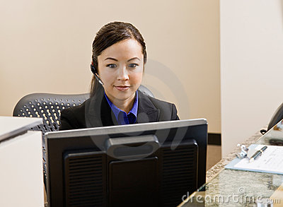 Receptionist with telephone earpiece