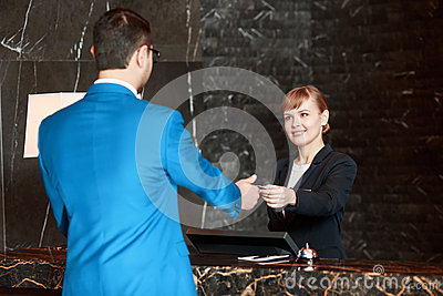 Receptionist At Work Behind The Counter Stock Photo ...