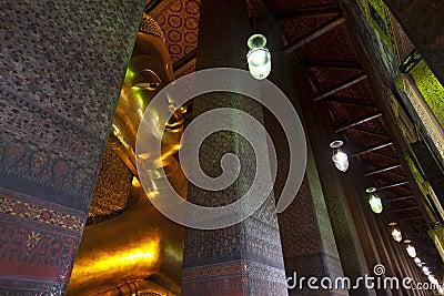 Reclining buddha Wat Pho in Bangkok Thailand.