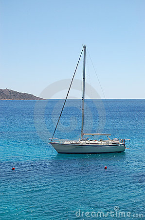 Recreation sail yacht at the beach of luxury hotel