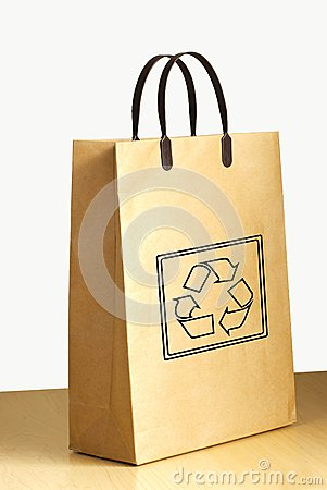 Recycle logo on paper bag on wooden floor