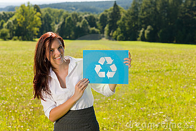 Recycling sign - Young businesswoman sunny meadow
