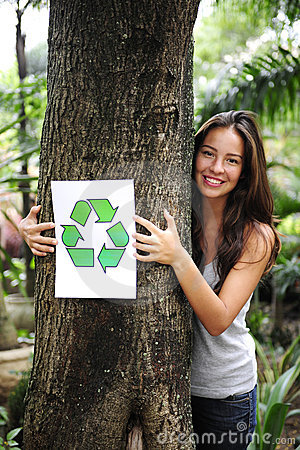Recycling: woman in the forest with recycle sign