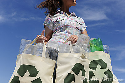 Recycling: woman holding bag