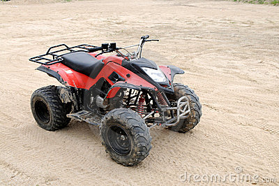 A red all terrain vehicle