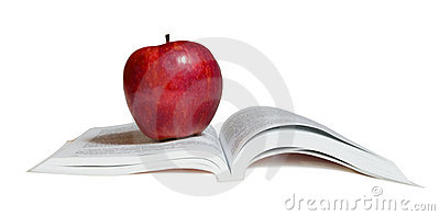 A red apple on  book