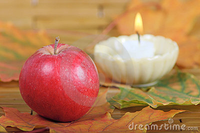 Red apple from candles on a background
