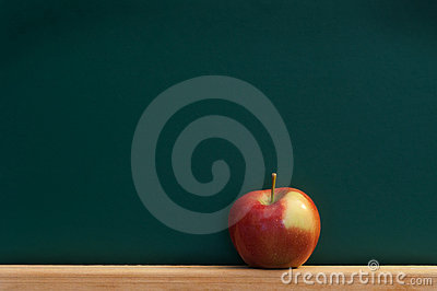Red apple on chalkboard