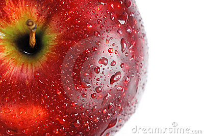 Red apple covered with drops of water
