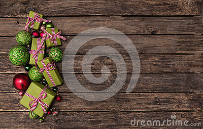 Red and apple green christmas presents with a checked ribbon on Stock Photo