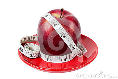 Red apple with measuring tape on red plate