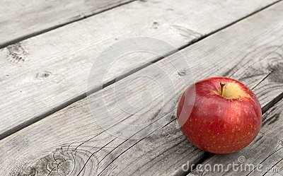 Red apple on old wooden table