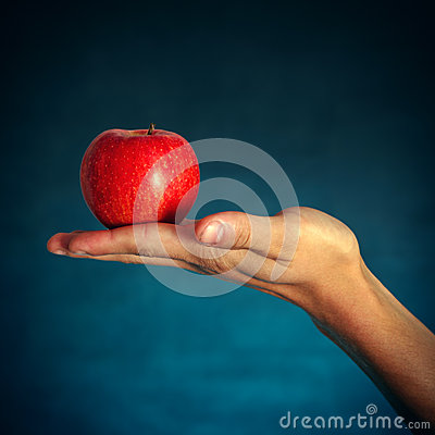 Free Red Apple On The Hand Royalty Free Stock Image - 47990746