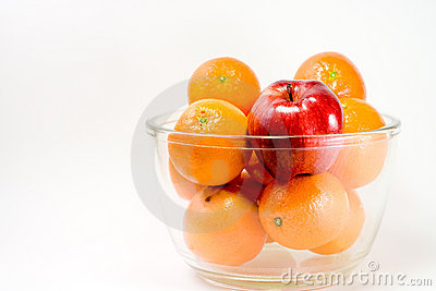 A Red Apple and Oranges in a Bowl