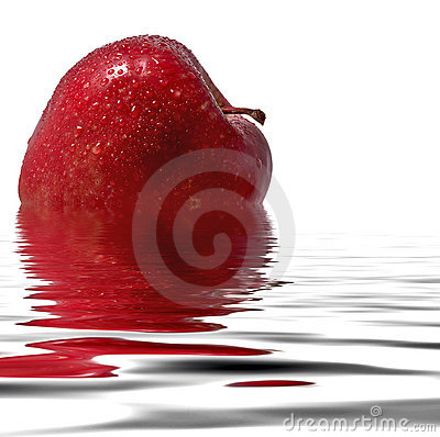 Red apple reflecting in the water