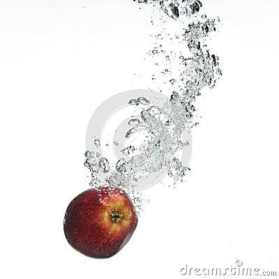 Red apple under water