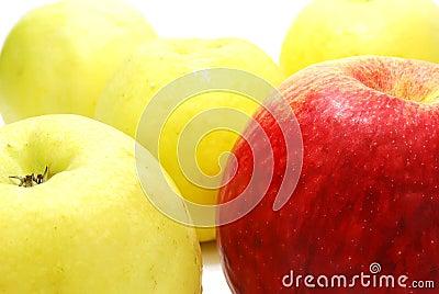 Red Apple between Yellow