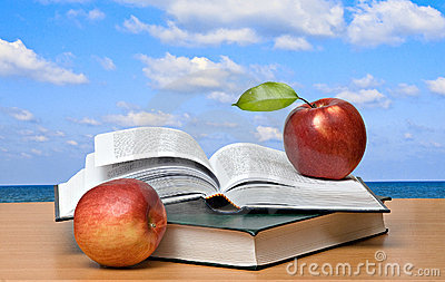 Red apples and  books
